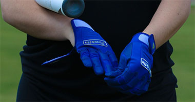 Fastpitch softball batting gloves in use