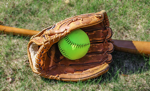 Softball glove on a field